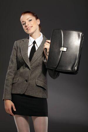 black briefcase: Empresaria con malet?negro Foto de archivo
