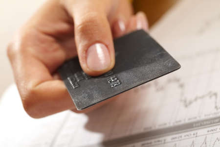 credit card in human hand  photo