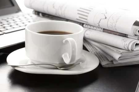 Cup of fragrant coffee on a morning paper business news Stock Photo - 9764114