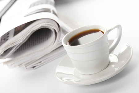financial newspaper: Cup of fragrant coffee on a morning paper business news