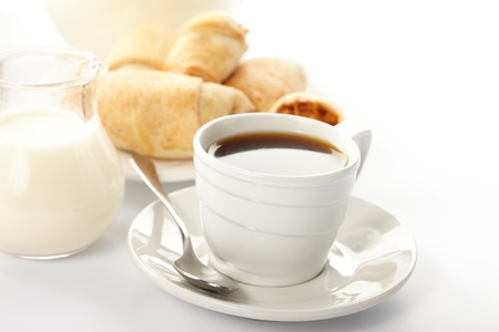 french bread rolls: Cup of coffee with a roll