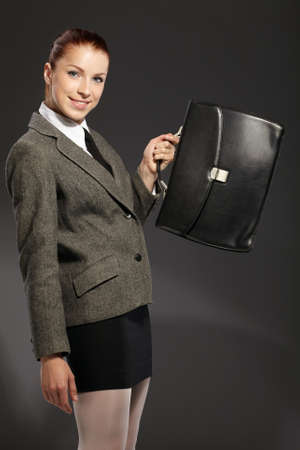 black briefcase: businesswoman with black briefcase Stock Photo