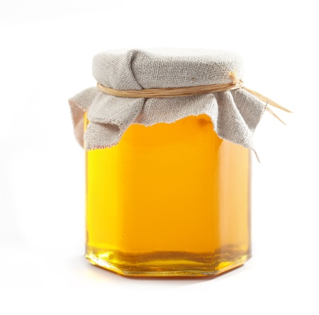 glass jar: Jar of honey Stock Photo