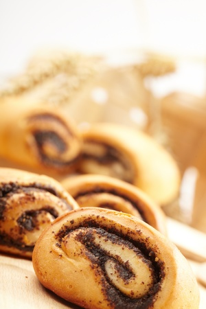 bakery products: Poppy rolls on the table Stock Photo