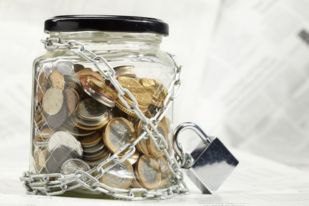 coins in money jar photo