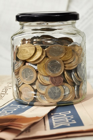 money jar: coins in money jar Stock Photo