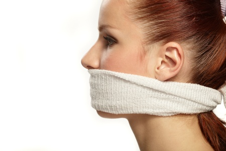 Cute young woman with white band on the mouth photo