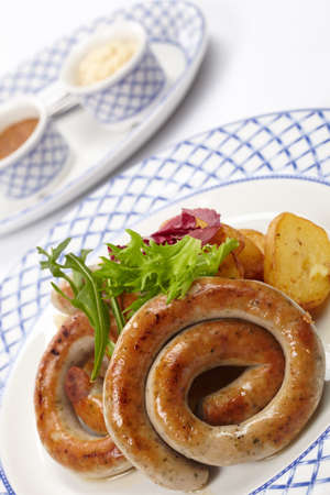 sausages and potatoes photo