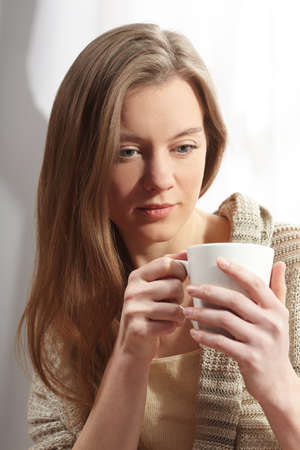 woman with cup of tea Stock Photo - 13324585