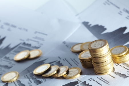 Business diagram on financial report with coins  Archivio Fotografico