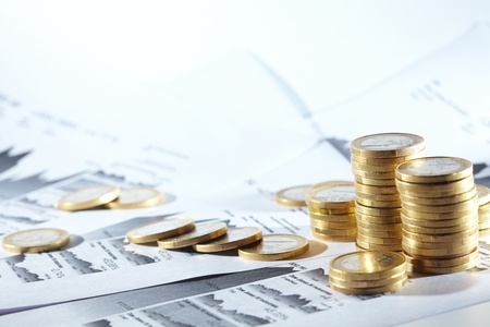 Business diagram on financial report with coins Reklamní fotografie - 14172803