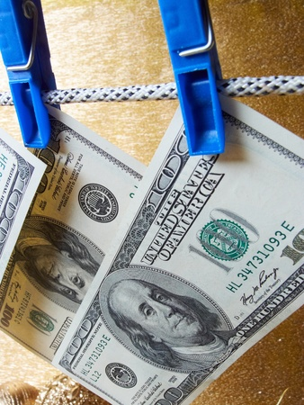 dollar bills hanging on a clothes pins  Stock Photo - 16725244