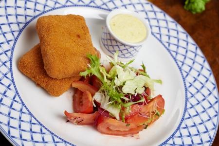 Schnitzel with salad photo
