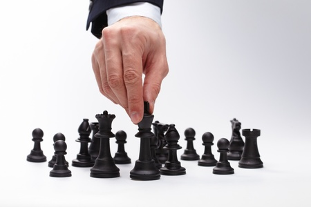 Business man moving chess figure Archivio Fotografico