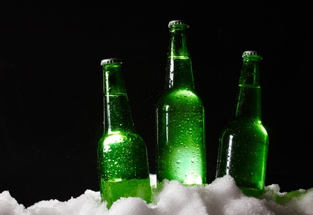 beer bottles in snow photo
