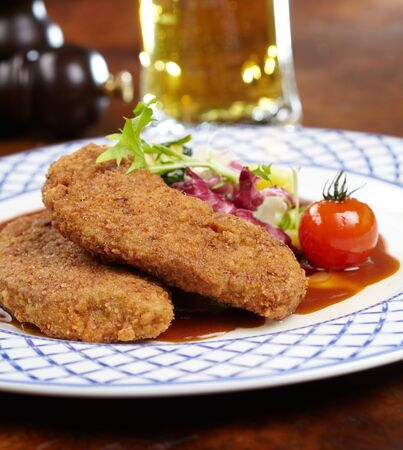 Schnitzel with salad photo
