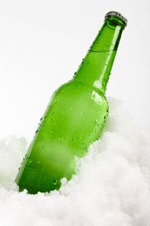 beer bottle in snow photo