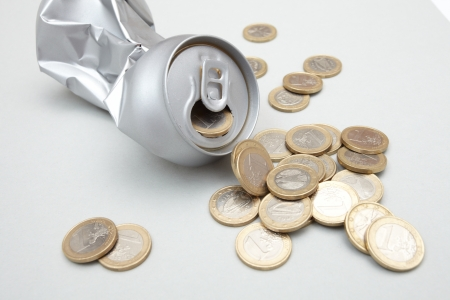 tailings: Crushed Aluminum Can with coins