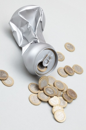 inhabited: Crushed Aluminum Can with coins