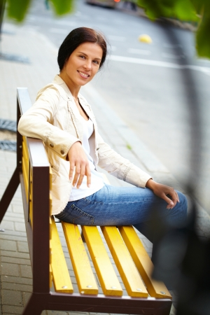 Woman with tablet on the bench photo