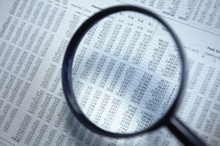 scrutinize: Magnifying glass on the document