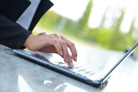 female hand writing on laptot photo