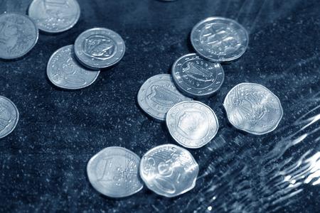 coins under water photo