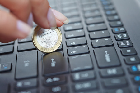 coin on laptop photo