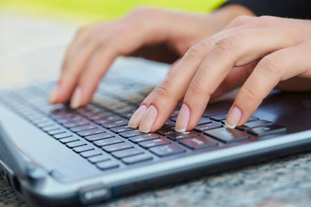 female hand writing on laptot Stock Photo
