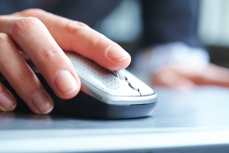 paypal: female hand clicking computer mouse