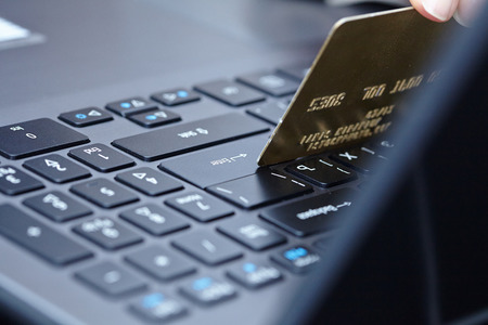 concep: woman holding credit card on laptop for online shopping concep Stock Photo