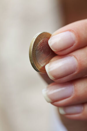 woman handing coins photo