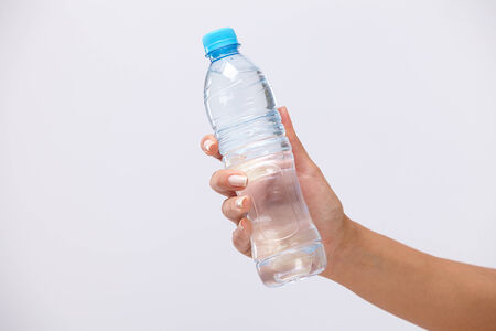woman hand with bottle of water photo