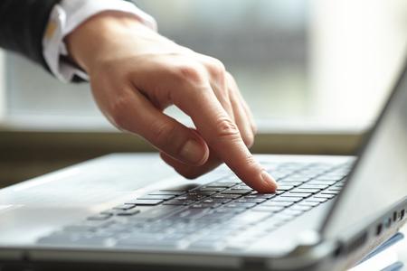 female hands on keyboard Stock Photo