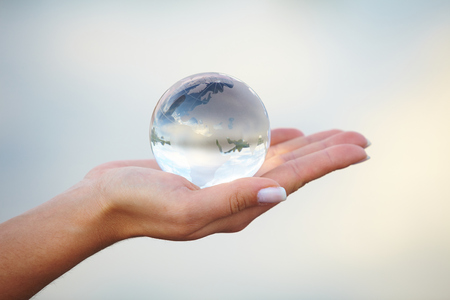 Crystal ball on hand photo