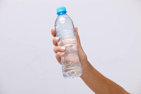 man drinking water: woman hand with bottle of water
