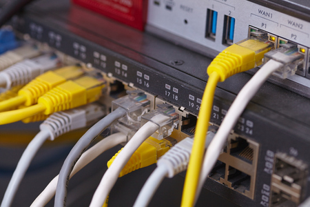 isp: network cables connected to switch Stock Photo