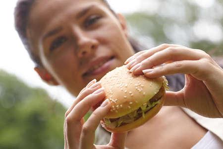woman eating hamburger photo