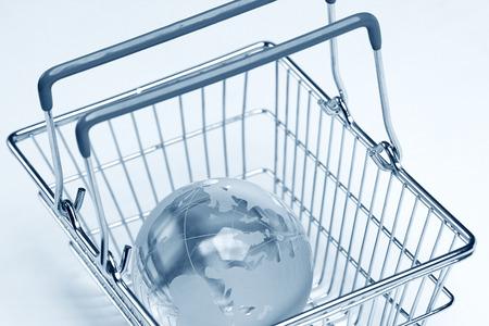 glass globe: glass globe in the shopping basket Stock Photo