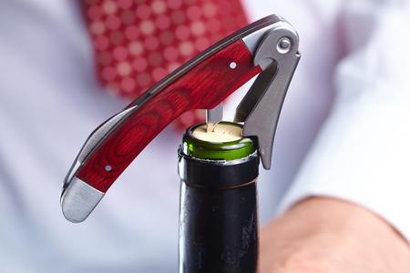 broaching: man opening a bottle of wine Stock Photo
