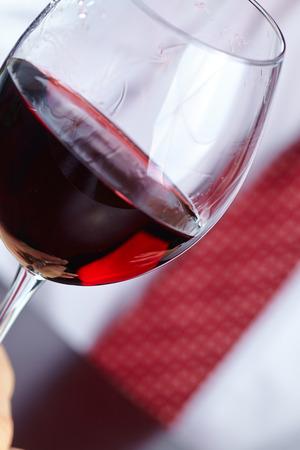 man handing glass of wine photo