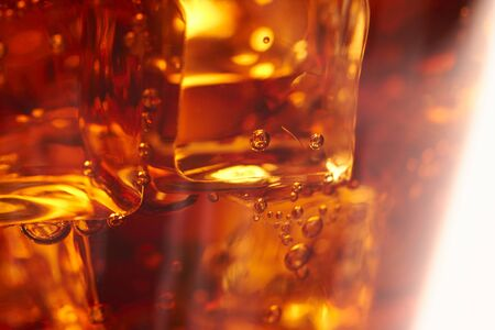cola with ice cubes photo