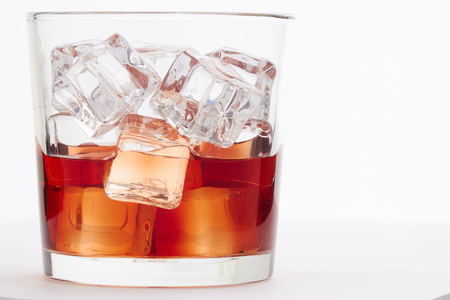 Whiskey with ice cubes photo