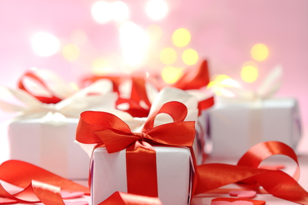 christmas shopping: gifts with red ribbons