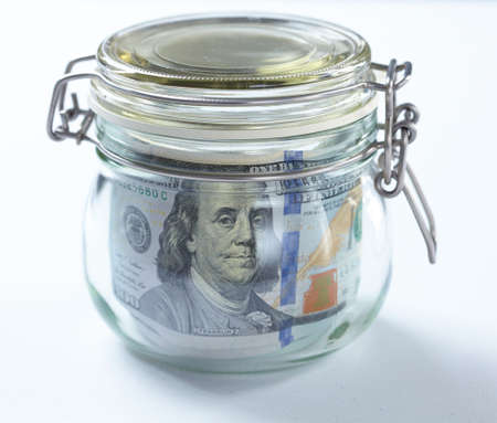 meanness: money in glass jar