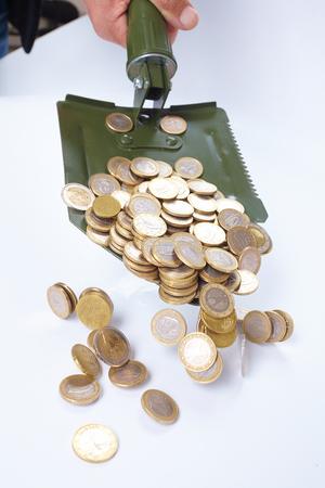 financial reward: shovel with money Stock Photo