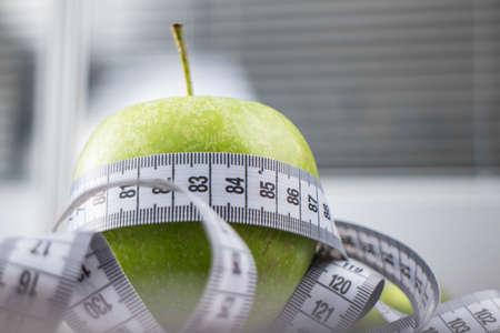 measuring tape: green apples with measuring tape