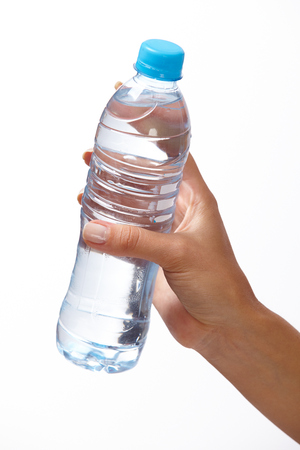 non alcoholic beverage: woman hand with bottle of water