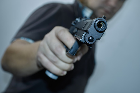 Hombres con el arma Foto de archivo