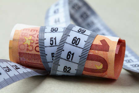 twining: euro with measuring tape Stock Photo